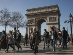 People wearing face masks on the Champs-Elysees in Paris (Michel Euler/AP)