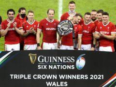 Wales celebrate winning the Six Nations triple crown (David Davies/PA)