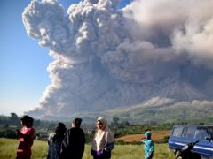 Nearby villages were on high alert as Indonesia's Mount Sinabung volcano continued to erupt and spew ash across the region (AP)