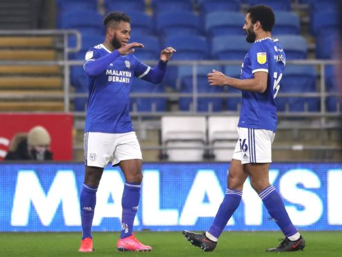 Leandro Bacuna (left) celebrates scoring Cardiff's first goal in their victory over Derby (Nick Potts/PA)