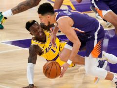 Los Angeles Lakers guard Dennis Schroder (left) loses control of the ball as Phoenix Suns guard Devin Booker takes it (Mark J Terrill/AP)
