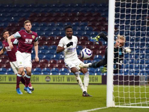 Leicester goalkeeper Kasper Schmeichel saves from Burnley's Chris Wood (Jon Super/PA)
