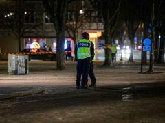 Police are seen in the area after several people were attacked in Vetlanda (Mikael Fritzon/TT News Agency via AP)