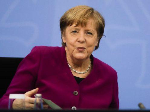 German Chancellor Angela Merkel attends a news conference (Markus Schreiber, Pool/AP)