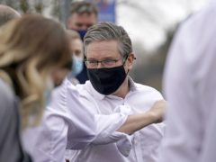Labour leader Sir Keir Starmer elbow bumps a member of staff during a visit to Royal Derby Hospital (Christopher Furlong/PA)