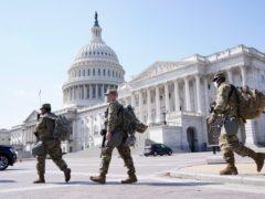 National Guard members walk near the Capitol (Jacquelyn Martin/AP)