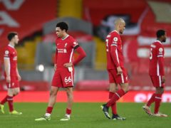 Liverpool's dejected players following their 1-0 home defeat by Chelsea (Laurence Griffiths/PA)
