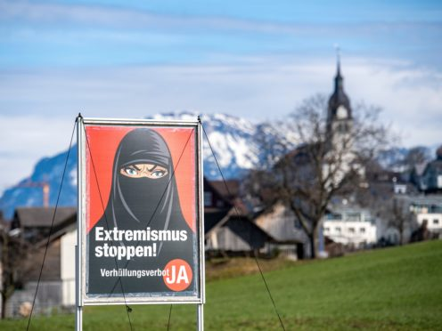 A poster supporting the ban on face coverings (Urs Flueeler/Keystone via AP)