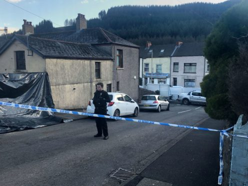 Police at the scene in the village of Ynyswen in Treorchy, Rhondda (Adam Hale/PA)