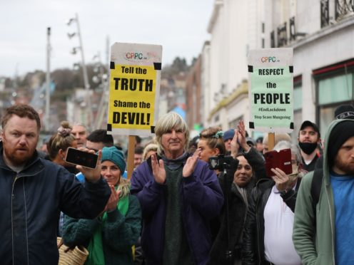 People part in a demonstration against lockdown restrictions organised by the People's Convention in Cork city centre (Niall Carson/PA)