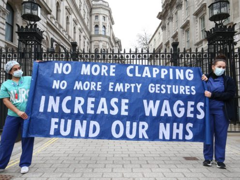 A senior minister has said he hopes NHS staff will receive an 'appropriate' pay rise (Peter Byrne/PA)