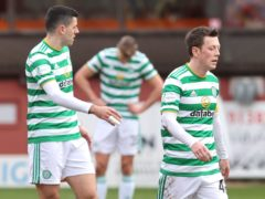 Callum McGregor (right) appears dejected at the final whistle as Celtic's goalless draw against Dundee United confirmed Rangers as champions (Jeff Holmes/PA Images).