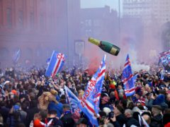 Rangers fans celebrate outside Ibrox (Robert Perry/PA)