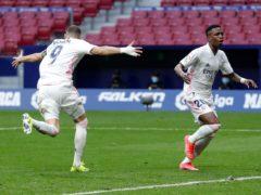 Karim Benzema, left, earned a point for Real Madrid against derby rivals Atletico (Manu Fernandez/AP)