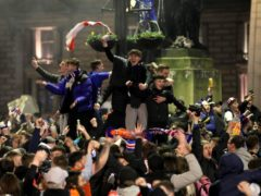 Fans celebrate in George Square after Rangers won the Scottish Premiership title (Jane Barlow/PA)