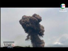Smoke rising over the blast site at a military barracks in Bata, Equatorial Guinea (AP)