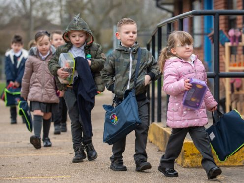 Children arrive at Thomas Bullock Church of England Primary Academy in Shipdham in Norfolk (Joe Giddens/PA)