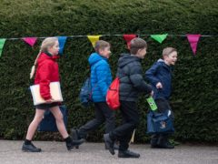 Children arrive at Thomas Bullock Church of England Primary Academy in Shipdham in Norfolk (Joe Giddens/PA)