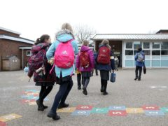 Children arrive at Manor Park School and Nursery in Knutsford, Cheshire (Martin Rickett/PA)