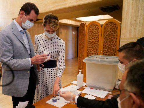 Syrian President Bashar Assad, left, and his wife Asma (Syrian Presidency/AP)