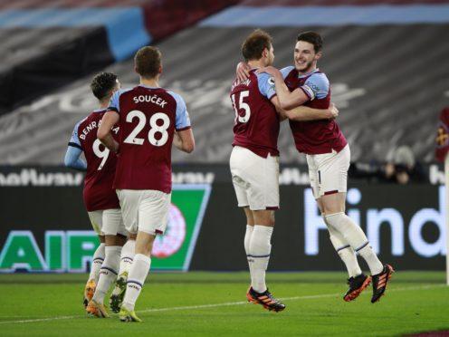 Craig Dawson (second right) celebrates West Ham's second goal with his team-mates (Ian Walton/PA)