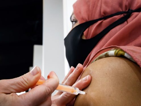 A woman receives an injection of the the Oxford/AstraZeneca coronavirus vaccine (PA)