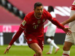 Bayern Munich frontman Robert Lewandowski completed a hat-trick in the first half against Stuttgart (Matthias Schrader/AP)