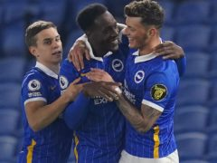 Danny Welbeck (centre) celebrates with team-mates Leandro Trossard (left) and Ben White after scoring the second goal in a 3-0 win over Newcastle (John Walton/PA Images).
