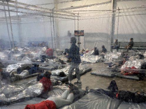 Detainees in a Customs and Border Protection temporary overflow facility in Donna, Texas (Photo courtesy of the Office of Rep. Henry Cuellar via AP)