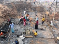 Rohingya refugees stand at the site of the fire (AP/ Shafiqur Rahman)