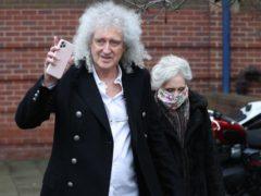 Brian May, with wife Anita Dobson, leaving Kingston Crown Court (Jonathan Brady/PA)
