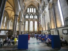 Cubicles inside Salisbury Cathedral, Wiltshire, for people to receive their coronavirus vaccinations (Steve Parsons/PA)