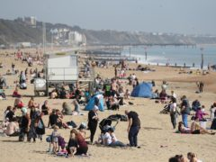 People enjoy the warm weather on Bournemouth beach in Dorset (Andrew Matthews/PA)