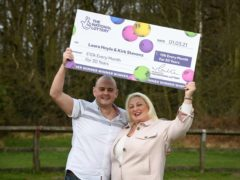 Kirk Stevens and Laura Hoyle did not realise they had won the prize for 13 days (National Lottery/PA)