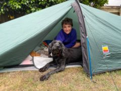 Max Woosey, 11, has spent a year camping in his garden to raise money for a hospice which looked after a family friend (Woosey family/PA)