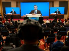 Chinese Foreign Minister Wang Yi speaks during a remote video press conference held on the sidelines of the annual meeting of China's National People's Congress in Beijing (Mark Schiefelbein/AP)