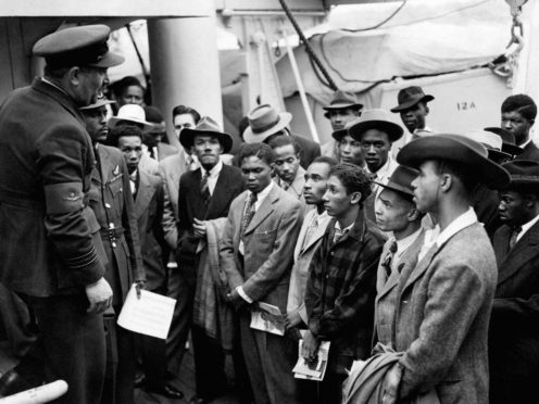 Jamaican immigrants arriving at Tilbury on the Empire Windrush (PA)