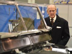 The Duke of Edinburgh looks at a Black 1960s ceremonial Land Rover Series 2A Escort Rover formally owned by The Queen Mother (Ben Stansall/PA)