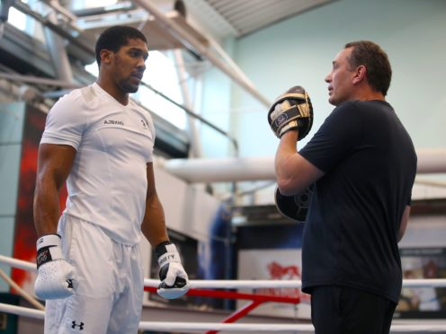 Anthony Joshua, left, might have to face Tyson Fury without Rob McCracken, right, in his corner (Nick Potts/PA)