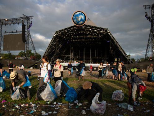 A clean-up begins in front of the pyramid stage at Glastonbury Festival (Aaron Chown/PA)