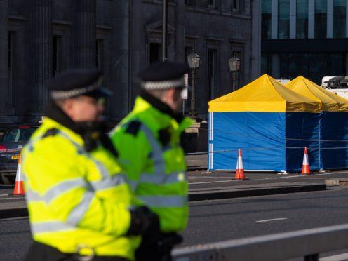 Police tents outside Fishmonger's Hall, on London Bridge, following the London Bridge terrorist attack.