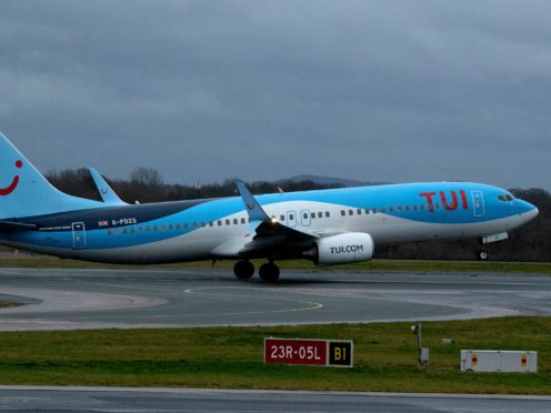 An IT glitch caused inaccurate weight calculations for a Tui flight after female passengers using the title 'Miss' were classified as children, an investigation has found (Peter Byrne/PA)