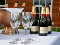 Bottles of Moet and Chandon champagne with The National Lottery branded champagne flutes (Peter Byrne/PA)