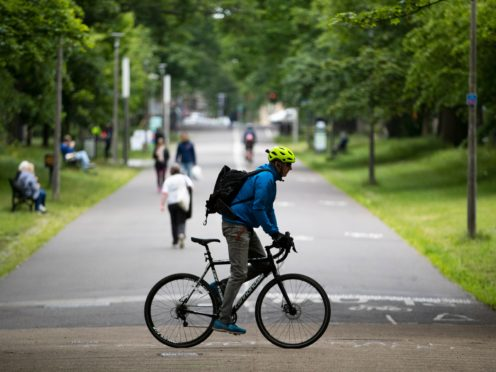 A man cycles through The Meadows in Edinburgh (Jane Barlow/PA)