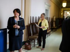 First Minster Arlene Foster (left), and deputy First Minister Michelle O'Neill in the hallway together before a Northern Ireland Executive press conference (PA)