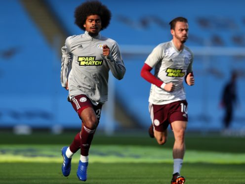 Leicester City's Hamza Choudhury (left) and James Maddison warming up before the Premier League match at the Etihad Stadium, Manchester.