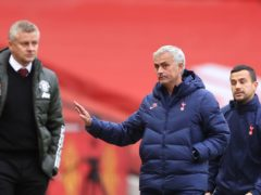Jose Mourinho, centre, does not agree with Ole Gunnar Solskjaer's opinion on winning trophies (Carl Recine/PA)