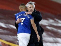 Everton manager Carlo Ancelotti, right, hugs Richarlison (Phil Noble/PA)