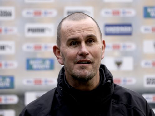 Mark Robinson has a decision to make at the heart of AFC Wimbledon's defence (Steven Paston/PA)