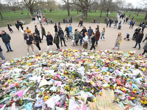 Flowers in Clapham Common in tribute to Sarah Everard. Sadiq Khan will pledge tougher measures to combat violence against women and girls in London if re-elected mayor (Victoria Jones/PA)